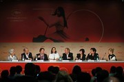 (FromL) Journalist Daniele Heymann, French actor Hippolyte Girardot, French actor Mathieu Amalric, French actress Marion Cotillard, French director Arnaud Desplechin, French actress Charlotte Gainsbourg, French actor Louis Garrel, and Italian actress Alba Rohrwacher attend on May 17, 2017 a press conference for the film 'Ismael's Ghosts' (Les Fantomes d'Ismael) ahead of the opening ceremony of the 70th edition of the Cannes Film Festival in Cannes, southern France.  / AFP PHOTO / Laurent EMMANUEL