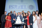 (L-R) Guri Weinberg, Sherri Shepherd, Eric Dickerson, Consul General of Israel, Los Angeles Sam Grundwerg, Yael Grobglas, Billy Crystal, Kelsey Grammer, David Blu, Noa Tishby, Mayim Bialik, Elon Gold, Mike Burstyn, Liel Kolet and Gilat Rapaport attend the 70th Anniversary of Israel celebration in Los Angeles on Sunday, June 10, 2018.
