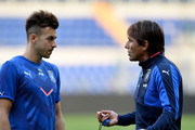 Head coach Antonio Conte (R) and Stephan El Shaarawy chat at the end of Italy training session at Stadio Olimpico on October 12, 2015 in Rome, Italy.