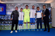 (L-R) Guest, Marco Verratti, Gianluigi Buffon, Giorgio Chiellini, Antonio Conte and Michele Uva of Italy attend Italy Unveils New Away Kit on September 2, 2015 in Florence, Italy.