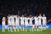 l-r  Jadon Sancho, Marcus Rashford, Harry Maguire, Harry Kane, Luke Shaw, Bukayo Saka, Raheem Sterling, Jack Grealish, John Stones and Kalvin Phillips look on during the penalty shoot out during the UEFA Euro 2020 Championship Final between Italy and England at Wembley Stadium on July 11, 2021 in London, England.