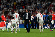 Gareth Southgate, Head Coach of England consoles Raheem Sterling of England after the UEFA Euro 2020 Championship Final between Italy and England at Wembley Stadium on July 11, 2021 in London, England.