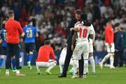 Raheem Sterling of England is consoled by Gareth Southgate, Head Coach of England after the UEFA Euro 2020 Championship Final between Italy and England at Wembley Stadium on July 11, 2021 in London, England.
