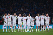 Players of England look on in a penalty shoot out during the UEFA Euro 2020 Championship Final between Italy and England at Wembley Stadium on July 11, 2021 in London, England.