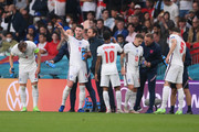 Declan Rice, Raheem Sterling and Kieran Trippier of England take a drink as they receive instructions from Gareth Southgate, Head Coach of England and Graeme Jones, Coach of England during the UEFA Euro 2020 Championship Final between Italy and England at Wembley Stadium on July 11, 2021 in London, England.