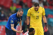 Leonardo Bonucci and Gianluigi Donnarumma of Italy check on Raheem Sterling of England following a challenge during the UEFA Euro 2020 Championship Final between Italy and England at Wembley Stadium on July 11, 2021 in London, England.