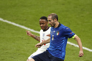 Giorgio Chiellini of Italy holds off Raheem Sterling of England during the UEFA Euro 2020 Championship Final between Italy and England at Wembley Stadium on July 11, 2021 in London, England.