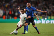 Raheem Sterling of England is challenged by Bryan Cristante of Italy during the UEFA Euro 2020 Championship Final between Italy and England at Wembley Stadium on July 11, 2021 in London, England.