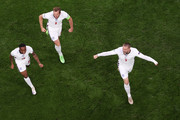 Luke Shaw of England celebrates with teammates Raheem Sterling and Harry Kane after scoring their team's first goal during the UEFA Euro 2020 Championship Final between Italy and England at Wembley Stadium on July 11, 2021 in London, England.