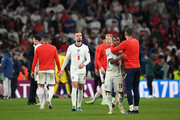 Raheem Sterling of England is consoled by Conor Coady of England following defeat in the UEFA Euro 2020 Championship Final between Italy and England at Wembley Stadium on July 11, 2021 in London, England.