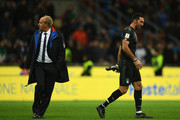 Gianluigi Buffon of Italy (R) and Head coach Italy Gian Piero Ventura dejected at the end of the FIFA 2018 World Cup Qualifier Play-Off: Second Leg between Italy and Sweden at San Siro Stadium on November 13, 2017 in Milan, Sweden.