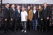 (L-R) IndyCar CEO Randy Bernard, President and CEO of Phillips-Van Heusen Corp Allen Sirkin, EVP Marketing of Phillips-Van Heusen Mike Kelly, racing legend Mario Andretti, Dancing with the Stars Champion and Izod IndyCar Series Driver Helio Castroneves, Izod IndyCar Series Drivers Ryan Briscoe and Simona de Silvestro, and Indianapolis Motor Speedway Corporation President and CEO Jeff Belskus attend an Izod party to celebrate the 100th Anniversary Indianapolis 500 at Classic Car Club on March 23, 2011 in New York City.