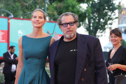 """Julian Schnabel and Louise Kugelberg walk the red carpet ahead of the """"J'Accuse"""" (An Officer And A Spy) screening during the 76th Venice Film Festival at Sala Grande on August 30, 2019 in Venice, Italy."""