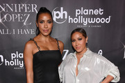 "Television personality Julissa Bermudez (L) and singer Adrienne Bailon attend the after party for the finale of the ""JENNIFER LOPEZ: ALL I HAVE"" residency at MR CHOW at Caesars Palace on September 30, 2018 in Las Vegas, Nevada."