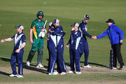 Cameron White of Victoria (C) celebrates the win as a dejected Jackson Bird of Tasmania look on during the JLT One Day Cup match between Victoria and Tasmania at Junction Oval on October 10, 2018 in Melbourne, Australia.