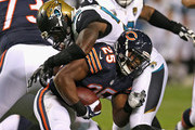Ka'Deem Carey #25 of the Chicago Bears is tackled by Allen Bradford #58 of the Jacksonville Jaguars during the third quarter of a preseason game at Soldier Field on August 14, 2014 in Chicago, Illinois. The Bears defeated the Jaguars 20-19.