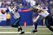 Blake Bortles #5 of the Jacksonville Jaguars attempts to break a tackle from Jabaal Sheard #93 of the Indianapolis Colts during the first half at Lucas Oil Stadium on October 22, 2017 in Indianapolis, Indiana.