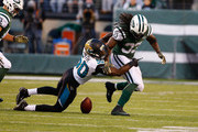 Chris Ivory #33 of the New York Jets fumbles the ball by  Telvin Smith #50 of the Jacksonville Jaguars in the fourth Quarter during their game at MetLife Stadium on November 8, 2015 in East Rutherford, New Jersey.