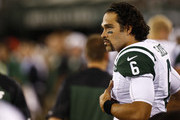 Mark Sanchez #6 of the New York Jets puts his hemet on the bench during their preseason game against the Jacksonville Jaguars at MetLife Stadium on August 17, 2013 in East Rutherford, New Jersey.
