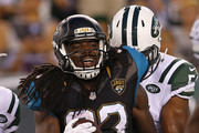Chris Ivory #33 of the Jacksonville Jaguars celebrates his one yard touchdown run against the New York Jets during the first quarter of an NFL preseason game at MetLife Stadium on August 11, 2016 in East Rutherford, New Jersey. The Jets defeated the Jaguars 17-13.