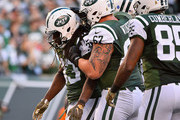 Chris Ivory #33 of the New York Jets is congratulated by his teammates after scoring a third quarter touchdown against the Jacksonville Jaguarsat MetLife Stadium on November 8, 2015 in East Rutherford, New Jersey.