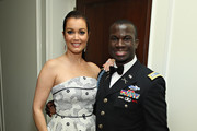 Actress Bellamy Young poses for a photo with Invictus Games medalist, Army Captain William Reynolds as Jaguar Land Rover sponsor Capitol File's White House Correspondents' Dinner Party on April 30, 2016 in Washington, DC.