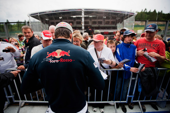 Jaime Alguersuari Jaime Alguersuari of Spain and Scuderia Toro Rosso signs autographs during previews to the Belgian Formula One Grand Prix at the Circuit of Spa Francorchamps on August 26, 2010 in Spa Francorchamps, Belgium.