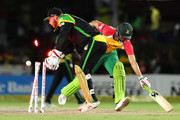FORT LAUDERDALE, UNITED STATES- AUGUST 18: In this handout image provided by CPL T20, Shoaib Malik of Guyana Amazon Warriors makes his ground during a direct hit during the Hero Caribbean Premier League match between Jamaica Tallawahs and Guyana Amazon Warriors at Central Broward Regional Park on August 18, 2018 in Florida, United States.