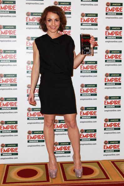(UK TABLOID NEWSPAPERS OUT) Noomi Rapace poses with her Best Actress Award in the press room at the Jameson Empire Awards 2011 held at Grosvenor House on March 27, 2011 in London, England.
