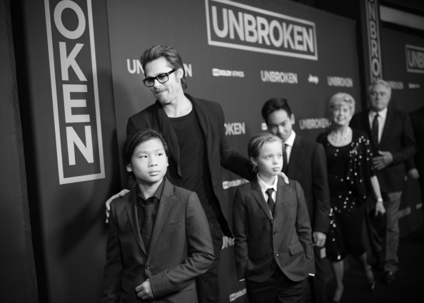 'Unbroken' Premieres in Hollywood — Part 2 [photograph,eyewear,social group,monochrome,snapshot,standing,photography,black-and-white,fun,font,brad pitt,shiloh nouvel jolie-pitt,jane pitt,maddox jolie-pitt,alternative view,c,unbroken,pax thien jolie-pitt,universal studios,premiere]
