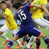 Taishi Taguchi Photos - Neymar of Brazil (L) in action during the international friendly match between Japan and Brazil at the National Stadium on October 14, 2014 in Singapore. - Japan v Brazil