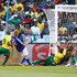 Keisuke Honda Photos - Keisuke Honda of Japan scores the first goal past Hamidou Souleymanou of Cameroon during the 2010 FIFA World Cup South Africa Group E match between Japan and Cameroon at the Free State Stadium on June 14, 2010 in Mangaung/Bloemfontein, South Africa. - Japan v Cameroon: Group E - 2010 FIFA World Cup