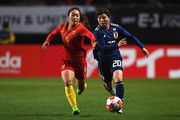 Miho Manya of Japan and Tang Jiali of China compete for the ball during the EAFF E-1 Women's Football Championship between Japan and China at Fukuda Denshi Arena on December 11, 2017 in Chiba, Japan.