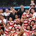 Michael Leitch Photos - Captain Michael Leitch of Japan (c),  coach Jamie Joseph (back row) and team Japan pictured in a team group after the Rugby World Cup 2019 Quarter Final match between Japan and South Africa at the Tokyo Stadium on October 20, 2019 in Chofu, Tokyo, Japan. - Japan v South Africa - Rugby World Cup 2019: Quarter Final