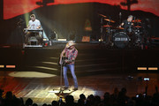 """(L-R) Pedal steel guitarist Jay Jackson, recording artist Jason Aldean and drummer Rich Redmond perform during the launch of Aldean's three-night """"JASON ALDEAN: RIDE ALL NIGHT VEGAS"""" engagement at Park Theater at Park MGM on December 6, 2019 in Las Vegas, Nevada."""