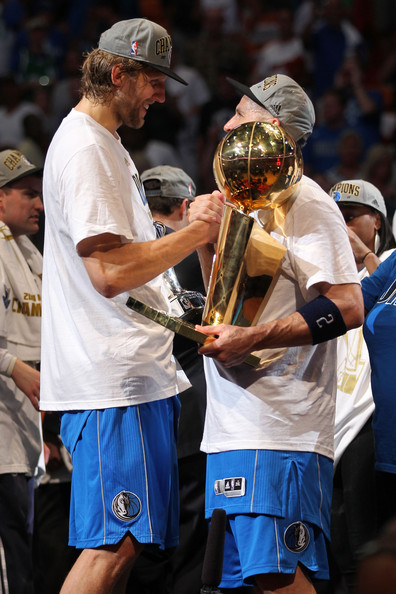 Dallas Mavericks v Miami Heat - Game Six [photograph,championship,competition event,player,tournament,trophy,team sport,sports,coach,sports equipment,world,jason kidd 2,dirk nowitzki 41,user,l-r,trophy,miami,game six,dallas mavericks,miami heat]