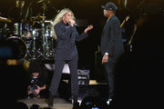 (L-R) Beyonce and and Jay Z perform on stage during a Get Out The Vote concert in support of Hillary Clinton at Wolstein Center on November 4, 2016 in Cleveland, Ohio. With less than a week to go until election day, Hillary Clinton is campaigning in Pennsylvania, Ohio and Michigan.