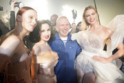 (L-R) Karen Elson, Dita Von Teese, Jean-Paul Gaultier and Karlie Kloss are seen backstage after walking the runway at the Jean-Paul Gaultier 50th Birthday show at Theatre du Chatelet on January 22, 2020 in Paris, France.