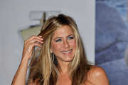 Jennifer Aniston attends photocall at the launch of her debut fragrance 'Lolavie' at Harrods on July 21, 2010 in London, England.