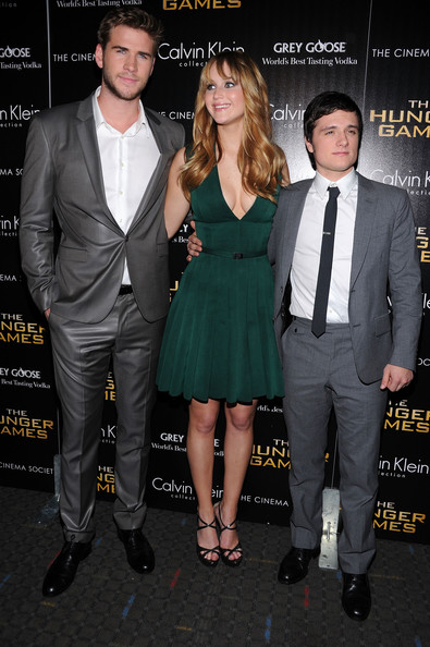 "Jennifer Lawrence (L-R) Liam Hemsworth, Jennifer Lawrence and Josh Hutcherson attend the Cinema Society & Calvin Klein Collection screening of ""The Hunger Games"" at SVA Theatre on March 20, 2012 in New York City."