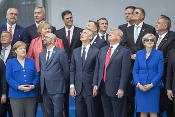 Jens Stoltenberg Theresa May World Leaders Meet For NATO Summit In Brussels
