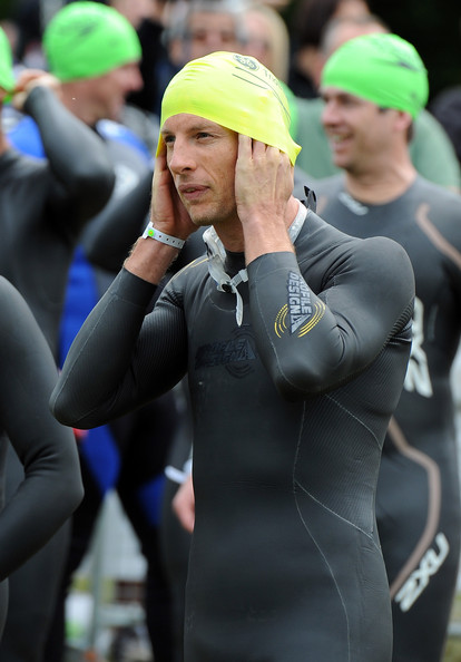 Jenson Button Jenson Button prepares ahead of the swim start during the GE Blenheim Triathlon at Blenheim Palace on June 5, 2011 in Woodstock, England.