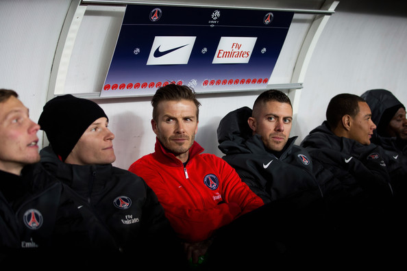 Paris Saint-Germain FC v Olympique de Marseille - Ligue 1 [red,team,event,coach,david beckham,team mates,v,bench,red top,parc des princes,paris saint-germain fc,olympique de marseille,ligue 1,match]