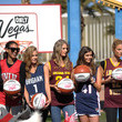 Jessica Perez LVCVA And Sports Illustrated Models Support NCAA Basketball Conference Championship At Historic Las Vegas Sign