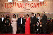 (L-R) Actor Danny Mooney, actress Michelle Thrush, actress Misty Upham, Director Arnaud Desplechin, guest, actor Benicio Del Toro, actress Gina McKee and writer Kent Jones attend the 'Jimmy P. (Psychotherapy Of A Plains Indian)' Premiere during the 66th Annual Cannes Film Festival at the Palais des Festivals on May 18, 2013 in Cannes, France.