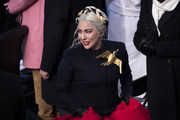 Lady Gaga departs from a podium after signing the national anthem during the inauguration of U.S. President-elect Joe Biden on the West Front of the U.S. Capitol on January 20, 2021 in Washington, DC.  During today's inauguration ceremony Joe Biden becomes the 46th president of the United States.