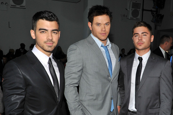 Joe Jonas Musician Joe Jonas, actors Kellan Lutz and Zac Efron attend the Calvin Klein Men's Collection Fall 2011 fashion show during Mercedes-Benz Fashion Week at 205 West 39th Street on February 13, 2011 in New York City.