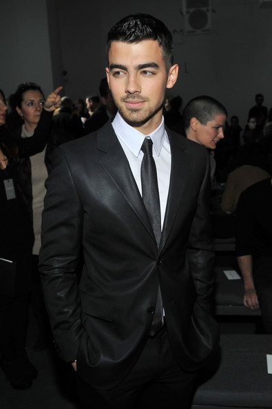 Calvin Klein Men's Collection - Front Row - Fall 2011 Mercedes-Benz Fashion Week [calvin klein mens collection fall 2011,suit,formal wear,tuxedo,hairstyle,fashion,event,blazer,outerwear,white-collar worker,premiere,joe jonas,calvin klein mens collection - front row,205 west 39th street,new york city,mercedes-benz fashion week,fashion show]
