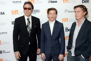 """(L-R) Actors Nicolas Cage, Tye Sheridan and director David Gordon Green arrive at the """"Joe"""" Premiere during the 2013 Toronto International Film Festival at Princess of Wales Theatre on September 9, 2013 in Toronto, Canada."""