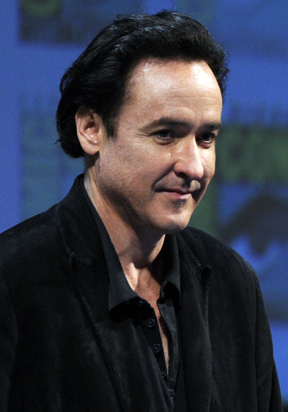 "John Cusack Actor John Cusack speaks at ""The Raven"" Panel during Comic-Con 2011 on July 22, 2011 in San Diego, California."